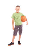 Child with basketball isolated on white background. Caucasian child with basketball, isolated on white background Royalty Free Stock Images