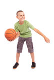 Child with basketball isolated on white background. Caucasian Child playing basketball, isolated on white background Stock Images