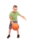 Child with basketball isolated on white background. Caucasian child with basketball, isolated on white background Stock Photography