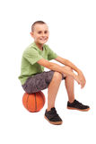 Child with basketball isolated on white background Stock Images
