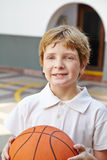 Child with basketball in physical education class Stock Photos