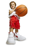 Child in basketball uniform and two balls Royalty Free Stock Image
