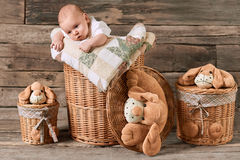 Child and baskets, wooden background. stock photo