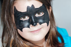 Child with bat face painting royalty free stock photography