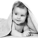 Child after bath black and white black and white. Cheerful baby blue eyes in beige towel black and white stock images