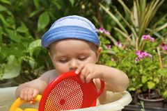 Child is bathed in a basin Stock Image
