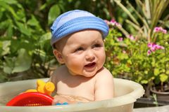 Child is bathed in a basin Stock Images