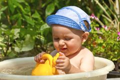 Child is bathed in a basin Royalty Free Stock Image
