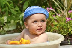 Child is bathed in a basin Royalty Free Stock Photography