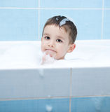 Child bathes in a bathroom Royalty Free Stock Photo
