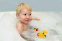A child bathes in a bathtub. Royalty Free Stock Image