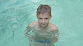 The child bathes in pool stock video footage