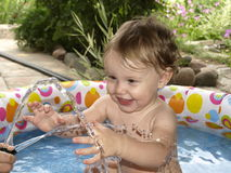 Child bathes royalty free stock photo