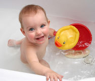 The child bathing in a bath Stock Photography