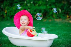 Child bathing  with foam bath Royalty Free Stock Image