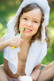 Child bathing outdoors in spring Royalty Free Stock Photography
