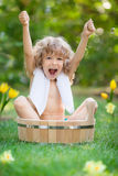 Child bathing outdoors in spring Stock Photos