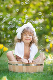 Child bathing outdoors in spring Royalty Free Stock Image