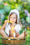 Child bathing outdoors in spring Royalty Free Stock Images