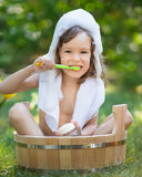 Child bathing outdoors in spring Royalty Free Stock Photo