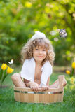 Child bathing outdoors in spring Royalty Free Stock Photos