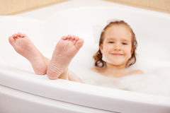 Child in the bathtub Stock Images