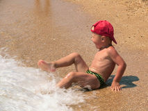 Child on a beach. Smiling boy play on a beach royalty free stock photography
