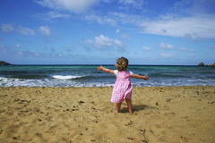 Child on beach royalty free stock images