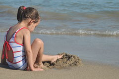 Child on the beach Stock Images