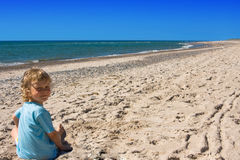 Child on beach Stock Images
