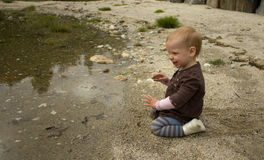 Child on the beach. Child playing with sand on a beach Stock Images