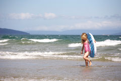 Child at beach. Little girl with inflated ring at the beach stock image
