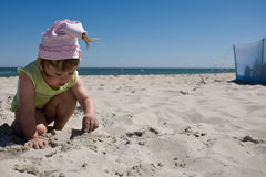 Child on beach. Little girl playing on the beach Royalty Free Stock Photos