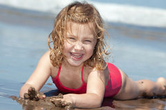 Child on the beach. Laughing little girl on the beach Stock Photo