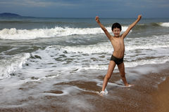 Child on the beach. With wave Royalty Free Stock Photos