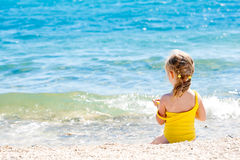 Child on the beach Stock Image