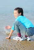 Child on the beach Stock Photos
