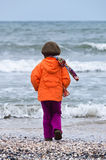Child on beach back view autumn Stock Photography