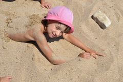 Child on the beach. Covered with sand Royalty Free Stock Photos