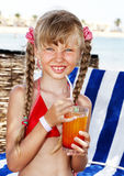 Child on beach drinking cocktail. Royalty Free Stock Photography