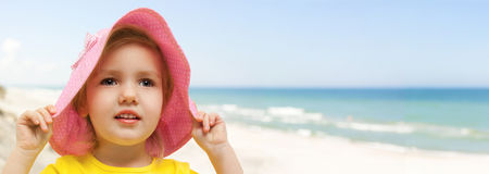 Child beach panoramic holding hat Royalty Free Stock Photography
