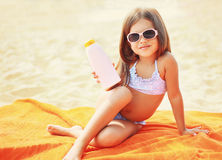 Child on the beach and showing sunscreen skin Royalty Free Stock Images