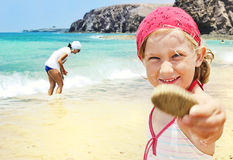 Child on the beach. Stock Photos