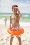 Child on beach in swimsuit royalty free stock images