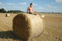 Child on a beam of straw Royalty Free Stock Image