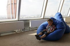 Child on bean bag Stock Photography