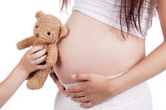 Child with bear by pregnant mom Royalty Free Stock Photo