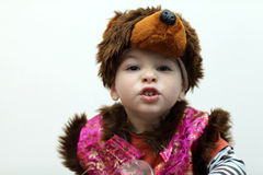 Child in a bear suit Stock Photography