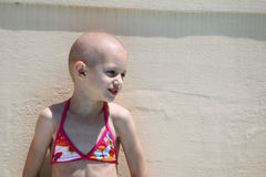Child beats cancer. Child enjoying a swim after sessions of chemotherapy Royalty Free Stock Images