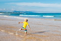 Child on tropical beach. Sea vacation with kids. Stock Images